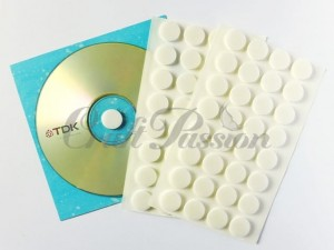 Mounting foam dots for CD/DVD
